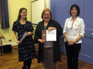 Jacqui Hogan receives her certificate for finishing 3rd in the 2013 MSC Table Topics Contest.