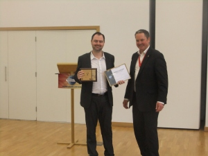 Chris receiving his trophy for Best Speaker award.