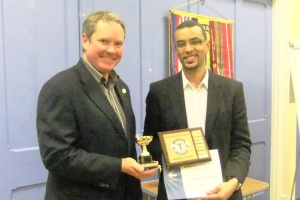 Evaluation Champ Yohan receiving his certificate & trophies from Mark.