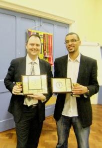 2014's International Club Contest winners: Chris Boden (Speech Contest) & Yohan McDonald (Evaluation Contest).