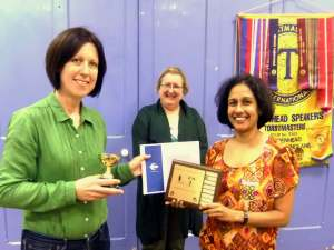 Lorraine Hamilton is presented with her certificate & trophies (from Area Governor Tracy Miranda & Chief Judge Jacqui Hogan) for winning the 2014 Club Humorous Speech Contest