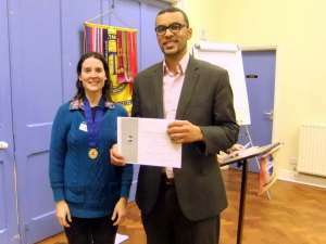 Admirable runner-up for the second time tonight, Yohan McDonald receives his certificate for the Evaluation Contest from Julie.