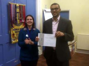 Yohan receiving his certificate for finishing as runner-up in the Club Speech Contest.